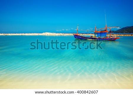 Malibu beach with boat at Koh Phangan Island, Thailand - stock photo