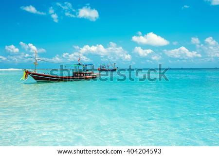 Malibu beach with boats at Koh Phangan Island, Thailand - stock photo