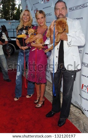 "MALIBU, CA - AUGUST 05: Eloise Dejoria with Tori Spelling and John Paul Dejoria at ""Bow Wow Ciao"" to Benefit Much Love Animal Rescue on August 05, 2006 at John Paul and Eloise Dejoria Estate in Malibu - stock photo"