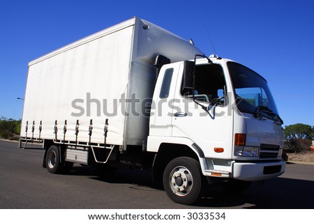 mall white truck - stock photo