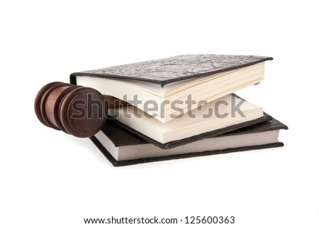 mallet and books on a white background - stock photo