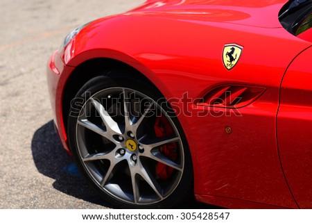 MALLORCA - JULY 31, 2015: Ferrari parked in old town Valldemosa in Mallorca.  - stock photo