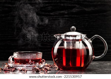 Mallow tea in glass with dried mallow blossoms - stock photo