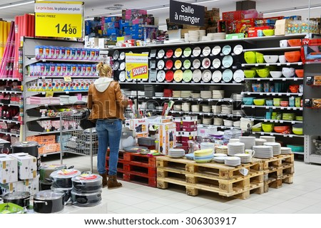 MALMEDY, BELGIUM - JULY 27: Customer in the Household appliances section of a Carrefour Hypermarket, a French multinational retailer, and large hypermarket chain. taken on July 27, 2015 in Belgium - stock photo