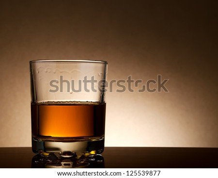 Malt whisky in a glass still life shot. - stock photo