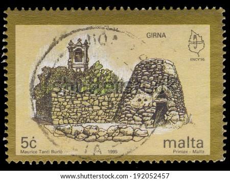 MALTA - CIRCA 1995: A stamp printed in Malta, shows European Nature Conservation. Ruins, Girna, circa 1995 - stock photo