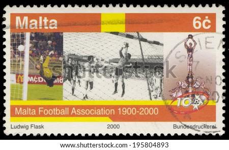 MALTA - CIRCA 2000: A stamp printed in Malta, shows Malta Football Association 1900-2000, circa 2000 - stock photo