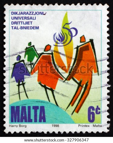 MALTA - CIRCA 1998: a stamp printed in the Malta shows Symbolic People, Emblem and Universal Declaration of Human Rights, circa 1998 - stock photo