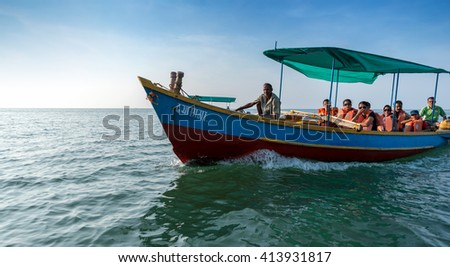 MALVAN, INDIA - November 12, 2015: Tourist traditional wooden boat at Devbag beach, Tarkarli, Malvan, Konkan, Maharashtra, India, Southeast Asia. - stock photo