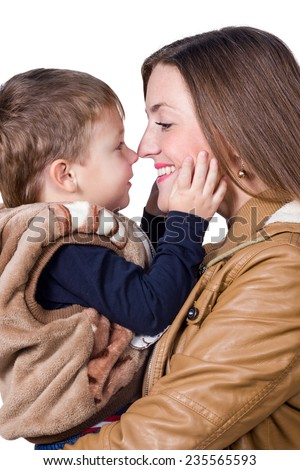 Mama holding his son and they touch each other noses isolated on white background - stock photo