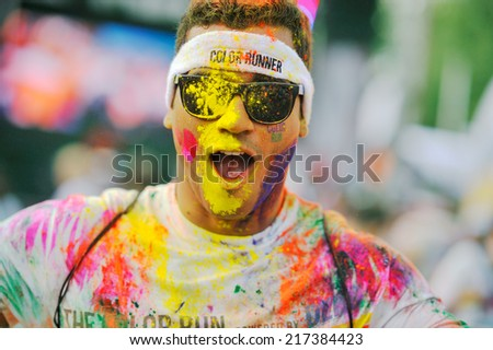 MAMAIA, ROMANIA - JULY 26: Crowds of unidentified people at The Color Run on July 26, 2014 in Mamaia, Romania. The Color Run is a worldwide hosted fun race with about 1500 competitors in Mamaia. - stock photo