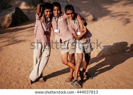 MAMALLAPURAM, INDIA - JAN 20: Unidentified hindu school children dressed in uniform go home after classes on January 20, 2013 in Madurai, Tamil Nadu, Southern India - stock photo