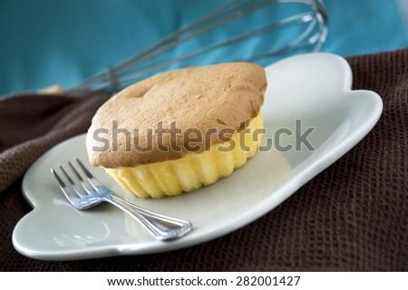 mamon philippines sponge butter cake on dish - stock photo