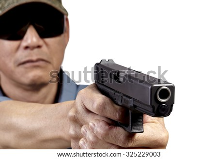 Man Aiming Handgun on White Background. Studio props. Selective Focus. Professional law enforcement and executive personal protection services. - stock photo