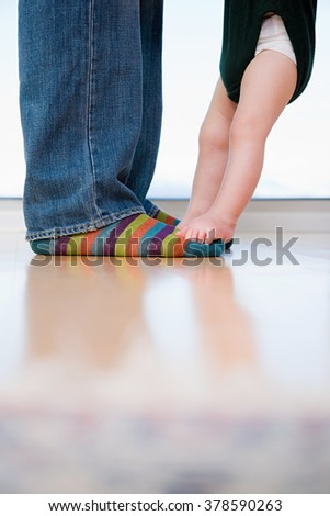 man and a babys feet - stock photo