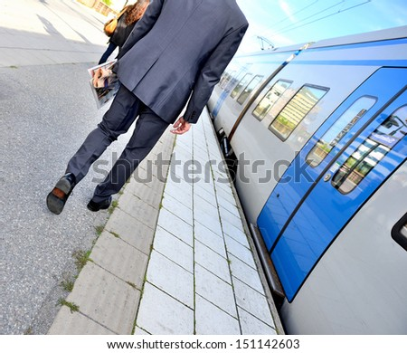 Man and commuter train - stock photo