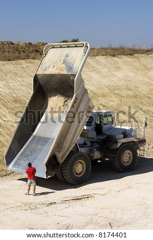 Man and construction truck - stock photo