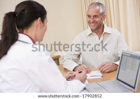 Man and doctor talking in office - stock photo