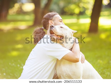 Man and Dog in the park. - stock photo