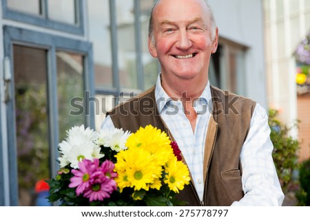 Man and flowers - stock photo