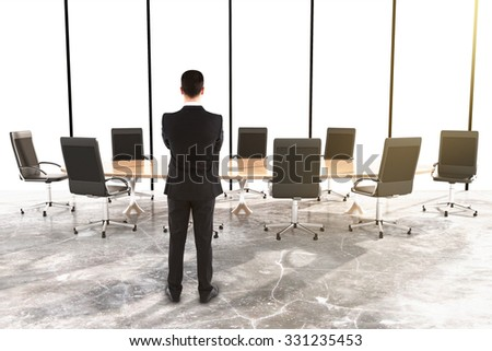 Man and furniture in a conference room with concrete floor 3D Render - stock photo