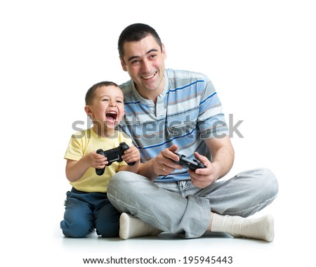 man and his son child play with a playstation together - stock photo