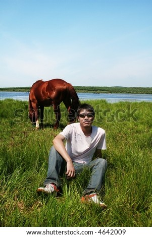 man and horse - stock photo