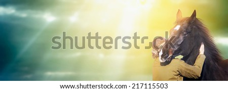 Man and horse against backdrop of  sun rays on autumn sky, banner for website - stock photo