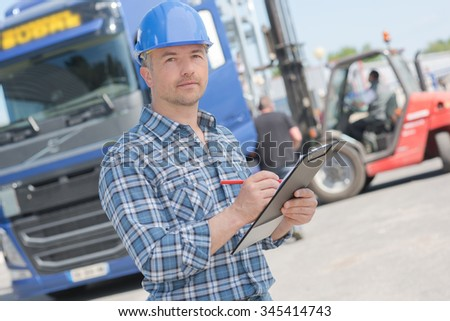 man and lorry - stock photo