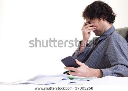 Man and  lots of paper work, looking stressed - stock photo