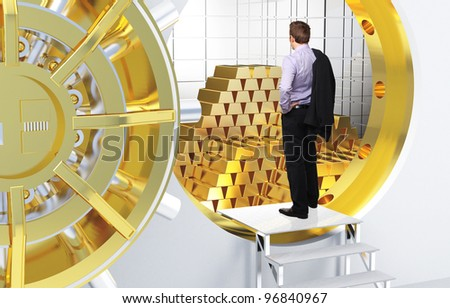 man and vault with golden bars - stock photo