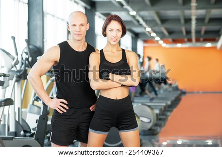Man and woman after sport exercises at the fitness gym. - stock photo