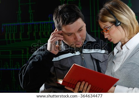 Man and woman are making consultation in power distribution control center - stock photo