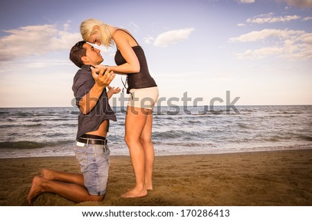 Man and woman arguing on the beach  - stock photo