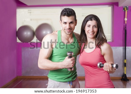 Man and woman at fitness room gym - stock photo