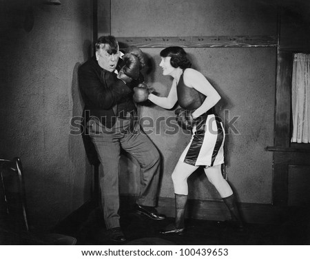 Man and woman boxing - stock photo