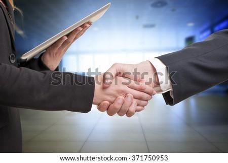 Man and woman business handshake - stock photo