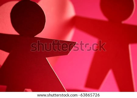 man and woman cut out of paper - stock photo