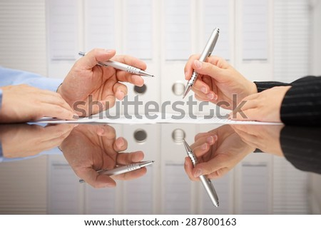 man and woman discussing on business meeting about document - stock photo