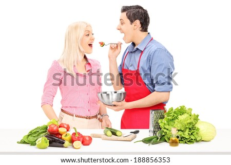Man and woman enjoy cooking together isolated on white background - stock photo