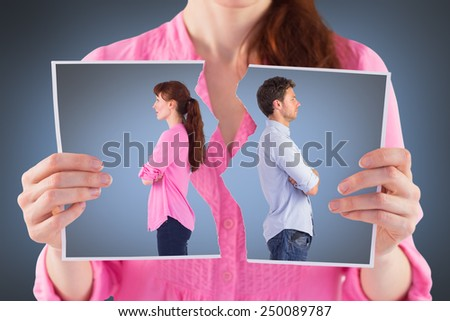 Man and woman facing away against grey vignette - stock photo