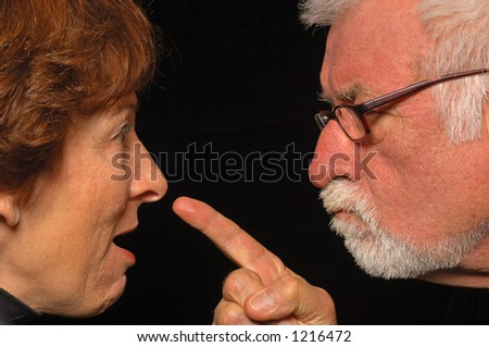 MAn and woman fight and point blame - stock photo