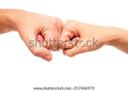 Man and woman fists isolated on white - stock photo