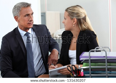Man and woman flirting in office - stock photo