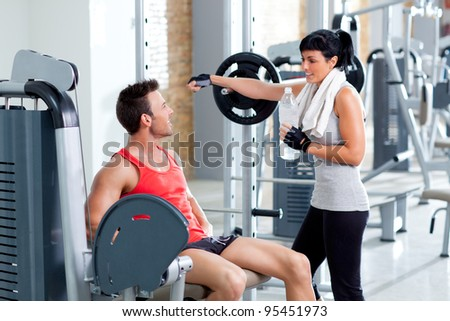 man and woman friends on sport fitness gym relaxed - stock photo