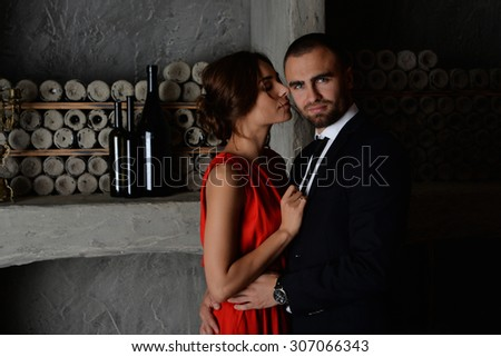 man and woman(girl/lady). man dressed in black suit. woman in dress. They love each other. love story. pre wedding shooting. Models in black, white and red. romance. relation. mirror . luxury  - stock photo