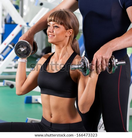 man and  woman goes in for sports in sport hall - stock photo