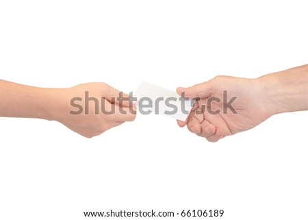 Man and woman hands passing each other a business card - stock photo