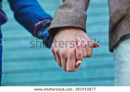 Man and woman holding by hands - stock photo