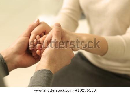 Man and woman holding hands closeup - stock photo